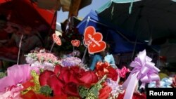 FILE: Flowers are displayed for sale ahead of the Valentine's Day at a flower market in central Phnom Penh, Cambodia, February 14, 2016. (Reuters)