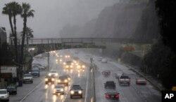 FILE - Motorists drive along Pacific Coast Highway in the rainy weather, Monday, Dec. 20, 2010, in Santa Monica, Calf. (AP Photo/Danny Moloshok)