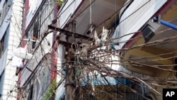 Electric cables in Rangoon, Jan. 27, 2014. World Bank on Sunday pledged $2 billion in loans, grants and investments to help improve Myanmar's ailing energy sector and health care.