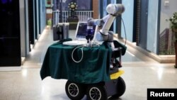 This photo shows a robot designed to help medical workers treat coronavirus patients is seen, after being placed for pictures, during a demonstration for the media at the aerospace engineering school of Tsinghua University in Beijing, China March 4, 2020.
