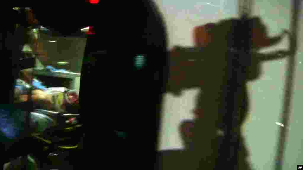 This still frame from video shows Boston Marathon bombing suspect Dzhokhar Tsarnaev visible through an ambulance after he was captured in Watertown, April 19, 2013.