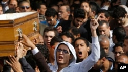 Relatives and colleagues of Mohammed Reda, 19, an Egyptian student who was killed Thursday during clashes with security forces near Cairo University, chant slogans as they carry a coffin following Friday prayers in Cairo, Egypt, Friday, Nov. 29, 2013.