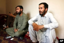 Ramal Ahmadi, right, speaks during an interview with AP about a U.S. drone strike in Kabul, Afghanistan, Sept. 2, 2021. Ahmadi said the strike killed 10 members of his family.