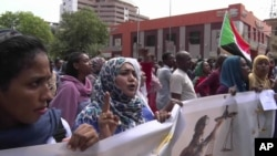 In this picture from video, Sudanese women rally on the streets of the capital, in Khartoum, Sudan, Sept. 12, 2019.