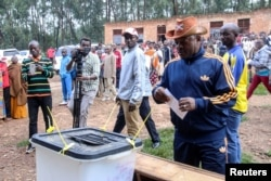 FILE - Burundi President Pierre Nkurunziza casts his ballot at a polling center during the constitutional amendment referendum at School Ecofo de Buye in Mwumba commune in Ngozi province, northern Burundi, May 17, 2018.