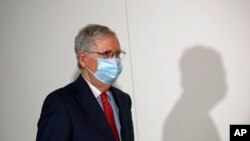Senate Majority Leader Mitch McConnell of Ky., wears a face mask used to protect against the spread of the new coronavirus as he attends a press conference after meeting with Senate Republicans at their weekly luncheon on Capitol Hill in Washington,…