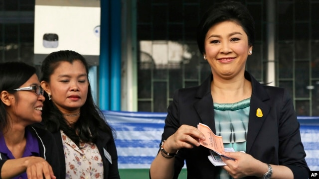 FILE - Thai Prime Minister and Pheu Thai party leader Yingluck Shinawatra poses before casting her ballot in Bangkok, Feb. 2, 2014.
