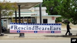 A banner sign hangs in Blanding, Utah, Monday, May 8, 2017, the day U.S. Interior Secretary Ryan Zinke toured Bears Ears National Monument on lands considered sacred by tribal groups.