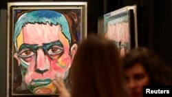FILE - A painting by David Bowie is set up for the the David Bowie exhibition in Berlin, Germany, May 14, 2014.