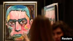 A painting by David Bowie is featured in an exhibit of his artwork in Berlin, Germany. May 2014 (REUTERS/Tobias Schwarz)