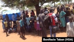 South Sudanese who fled fighting in their country wait in line to be registered as refugees in Uganda in March 2014. Some refugees in Uganda have spoken out against plans by the Juba government to hold elections in June 2015.