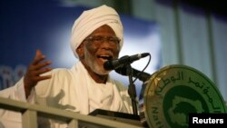 FILE - Islamist opposition leader Hassan al-Turabi gives a speech during the general conference of the ruling National Congress Party in Khartoum, Oct. 23, 2014. Prominent politician, 84, died on March. 5, 2016, of a heart attack.