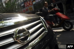 FILE - Japanese auto giants Nissan and Toyota said they would cut production in China because demand for Japanese cars has been hit by the diplomatic bitter row over disputed islands, Sept. 26, 2012..