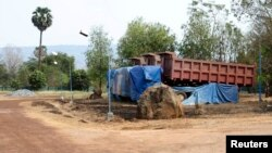 Trucks are seen in the compound of the Cambodia Iron Group at the Rovieng District in Preah Vihear province, February 10, 2013.