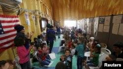 在美国的叙利亚难民问题处理中心,叙利亚难民儿童在玩耍(2016年4月6日)