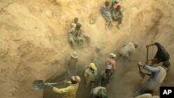 FILE - Miners dig for diamonds in Marange, eastern Zimbabwe.