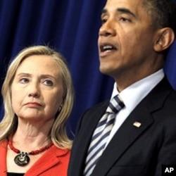 FILE - U.S. President Barack Obama announces that then-Secretary of State Hillary Clinton will travel to Burma, Nov. 18, 2011.