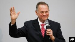 Former Alabama Chief Justice and U.S. Senate candidate Roy Moore speaks at a revival, Nov. 14, 2017, in Jackson, Alabama.