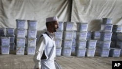 An Afghan election worker carries ballot boxes at the warehouse of Afghanistan's Independent Election Commission in Kabul, Afghanistan (File)