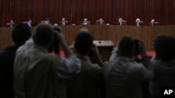 Judges sit in the Superior Electoral Court during the judgment phase of a trial involving allegations that the 2014 Rousseff-Temer ticket received illegal campaign financing in Brasilia, Brazil, June 6, 2017.