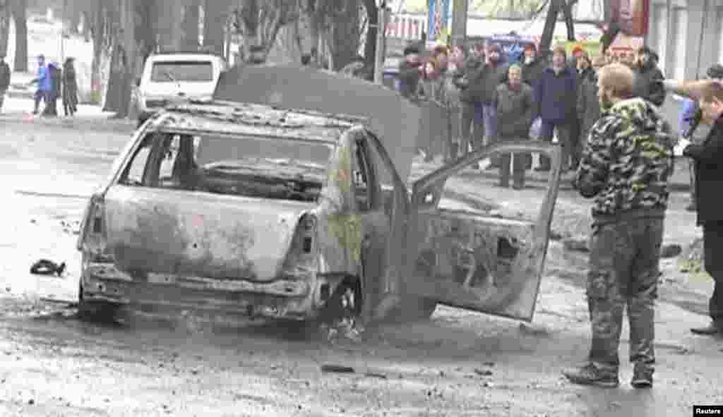 This still image captured from video footage shows a burned-out car destroyed by shelling in Donetsk, Jan. 22, 2015.