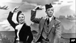 """Ginger Rogers and Fred Astaire in a publicity photo for the movie musical """"The Barkleys of Broadway"""""""