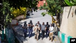 Security forces investigate the perimeters of the residence of Haitian President Jovenel Moise, in Port-au-Prince, Haiti, July 7, 2021. Gunmen assassinated Moise and wounded his wife in their home early Wednesday.