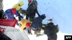 A screen grab from footage broadcast on Iranian state TV IRIB on Dec. 26, 2020, shows a search-and-rescue operation being conducted after a number of climbers were found dead because of avalanches north of Tehran. Several climbers remained missing.