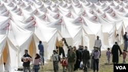 En la ciudad de Boynuyogun, en Turquía, se ha generado un campo de refugiados de sirios que huyen de la violencia en su país.