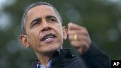 President Barack Obama speaks during a campaign event at Sloan's Lake Park in Denver, Colorado, Oct. 4, 2012.