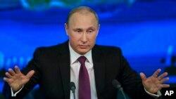 ປ. Vladimir Putin ກ່າວປາໄສຕໍ່ປະຊາຊົນ ທີ່ Moscow, ວັນທີ 18 ທັນວາ 2014.