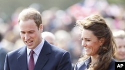 Britain's Prince William walks with his fiancee, Kate Middleton, during their visit to Witton Country Park in Darwen, northern England, April 11, 2011