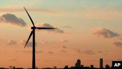 A wind turbine stands, generating power next to Hull, Massachusetts, Feb. 24, 2006.