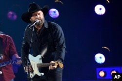 "Garth Brooks performs ""Ask Me How I Know"" at the 51st annual CMA Awards at the Bridgestone Arena, Nov. 8, 2017, in Nashville, Tennessee."