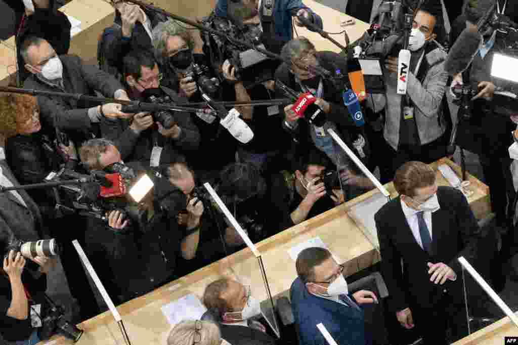 Sebastian Kurz, bottom right, leader of Austria's People's party and the party's parliamentary group leader, who recently resigned as Austrian Chancellor over a media corruption scandal, arrives to attend the parliamentary session at the Austrian Parliament in Vienna, Austria.