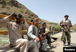 Armed men who are against Taliban uprising guard their check post, at the Ghorband District, Parwan Province, Afghanistan, June 29, 2021.