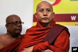 FILE - Myanmar's radical Buddhist monk Ashin Wirathu attends a media briefing in Colombo, Sri Lanka, Sept. 30, 2014.