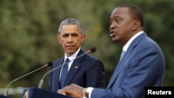 U.S. President Barack Obama (L) and Kenya's President Uhuru Kenyatta hold a joint news conference after their meeting at the State House in Nairobi, July 25, 2015.