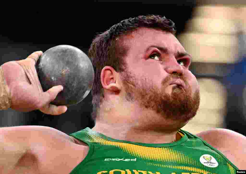 Kyle Blignaut of South Africa competes in qualifications for the men's shot put at the 2020 Summer Olympics in Tokyo, Japan.