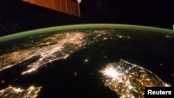 A NASA image shows a photo taken by the Expedition 38 crew aboard the International Space Station (ISS) of the night view of the Korean Peninsula.
