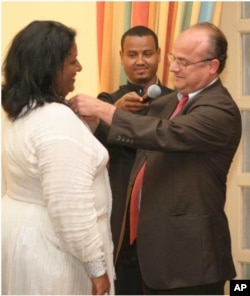 France's Ambassador to Ethiopia awarding Medal to Senedu in Addis Ababa
