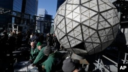 Workers prepare to install the last panels on the New Year's Eve ball above Times Square, New York, Dec. 27, 2017. The 12-foot diameter ball carries more than 2,600 Waterford crystals and is lighted by more than 32,000 LEDs.