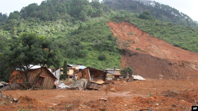 Structures lay in ruins at the site of a landslide in the village of La Pintada, Mexico, Sept. 19, 2013.