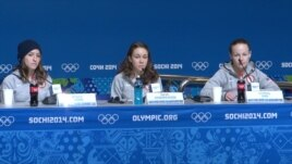 U.S. ski jumpers Jessica Jerome, Sarah Hendrickson and Lindsey Van speak to the media in Sochi, Feb. 10, 2014. (Parke Brewer/VOA)