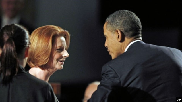 U.S. President Barack Obama and Australian Prime Minister Julia Gillard talk during a parliamentary dinner at Parliament House in Canberra, Australia, November 16, 2011.