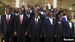 Ivory Coast's President Alassane Ouattara (C) poses with officials of his new government at the presidential palace in Abidjan, November 22, 2012.