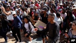 Students chant at the University of Cape Town as they protest for free education in Cape Town, South Africa, Sept. 20, 2016.