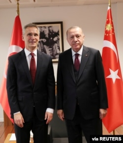 Turkish President Tayyip Erdogan meets with NATO Secretary General Jens Stoltenberg, left, in Brussels, Belgium, March 9, 2020.