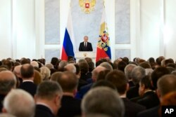 Russian President Vladimir Putin gives his annual state of the nation address before members of Federal Assembly in Moscow, Russia, Dec. 3, 2015.