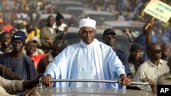 Senegalese President Abdoulaye Wade is surrounded by supporters and security as he travels between campaign stops in the suburbs of Dakar, Senegal Wednesday, Feb. 22, 2012. (AP)